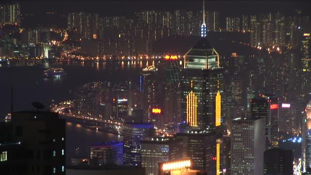 vídeos y material grabado en eventos de stock de view of city at night in hong kong china - central plaza hong kong
