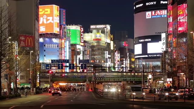 WS View of city at night with buildings and signboards / Shinjuku, Tokyo, Japan