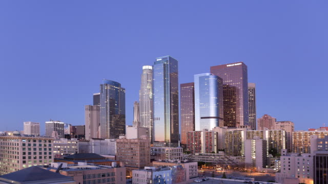 ws t/l view of city between night and day / los angeles, ca, united states   - day stock videos & royalty-free footage