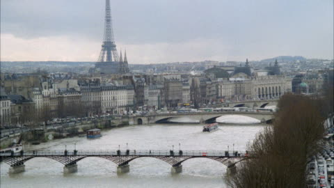 ws view of city boat travelling in river / paris, france - 1989 stock videos & royalty-free footage