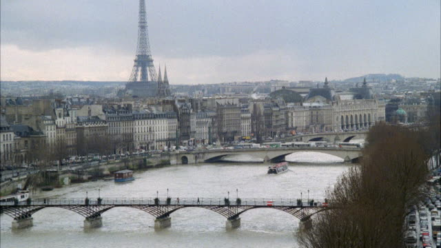 ws view of city boat travelling in river / paris, france - anno 1989 video stock e b–roll