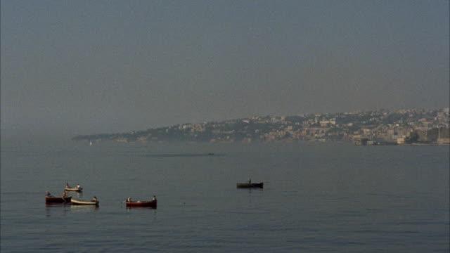 ms pan view of city boats ocean / rome, italy - ラツィオ州点の映像素材/bロール