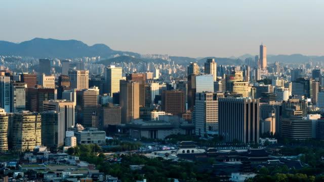 stockvideo's en b-roll-footage met view of city buildings around gwanghwamun square area from day to night in seoul - straatnaambord