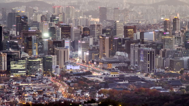 view of city buildings in gwanghwamun square (popular tourist attractions) area at day and night time in seoul - time of day stock videos and b-roll footage