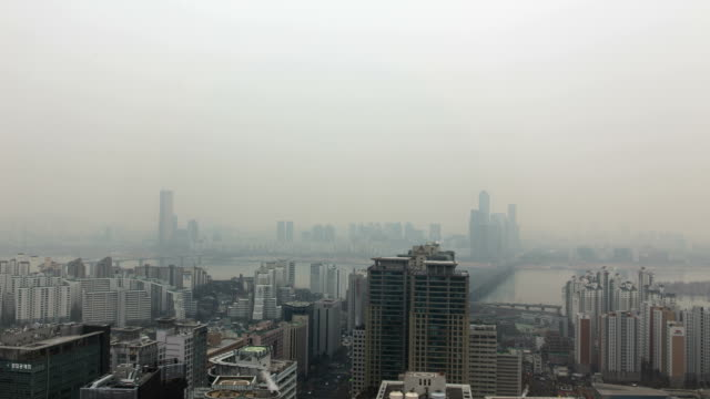 View of city buildings on the Yeouido (Financial district) and Han River in fine dust, Seoul