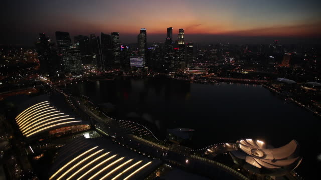 WS View of city cityscapes and bay at night / Singapore