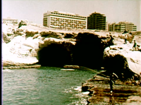 view of city fishing swimming, beruit, lebanon / audio - 1960 stock-videos und b-roll-filmmaterial
