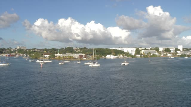vidéos et rushes de view of city from cruise ship as it leaves port, pointe-a-pitre, guadeloupe, french antilles, west indies, caribbean, central america - guadeloupe