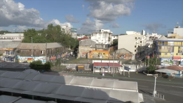 vidéos et rushes de view of city from cruise ship, pointe-a-pitre, guadeloupe, french antilles, west indies, caribbean, central america - guadeloupe