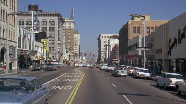 stockvideo's en b-roll-footage met ms ts view of city in rode and rush car / hollywood,california,united states - 1965