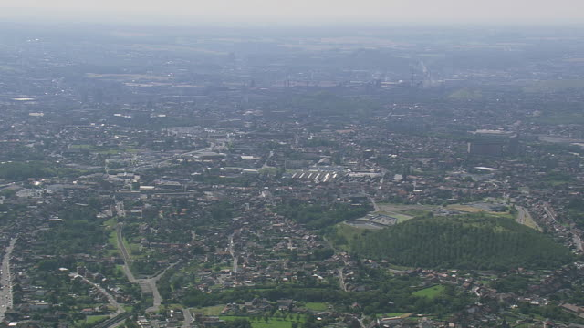 vidéos et rushes de ws aerial view of city, indusrial area and airport / walloon region, belgium - belgique