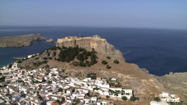 ms aerial ds view of city lindos in the island rhodes, rodos, focusing on the  archaeological site / rhodes, rodos, dodecanese islands, greece - rhodes dodecanese islands stock videos & royalty-free footage