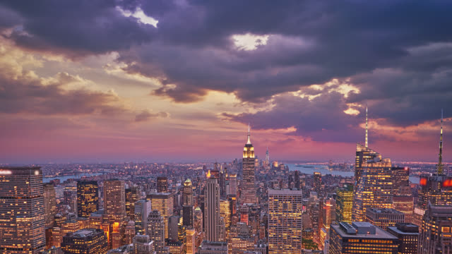 view of city lit up at day to night - new york city stock videos & royalty-free footage
