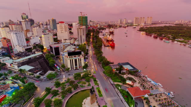 ws t/l view of city located near saigon river / ho chi minh city, vietnam - vietnam meridionale video stock e b–roll