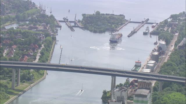 aerial ws view of city near river / kiel canal,schleswig-holstein, germany - schleswig holstein stock-videos und b-roll-filmmaterial