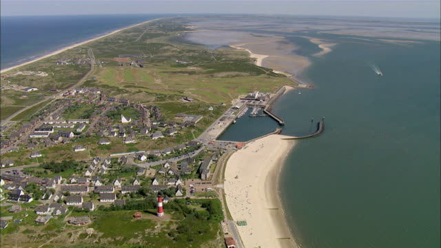 ws aerial view of city near river / sylt, schleswig-holstein, germany - sylt stock videos & royalty-free footage