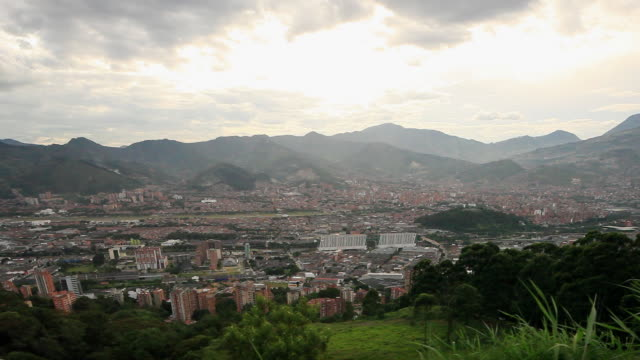 ews ha view of city of bogota spread out in a valley surrounded by mountains / medellin, colombia - medellin colombia stock videos & royalty-free footage