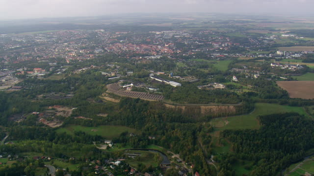 ws aerial view of city of freiberg and road way / germany - saxony stock videos & royalty-free footage