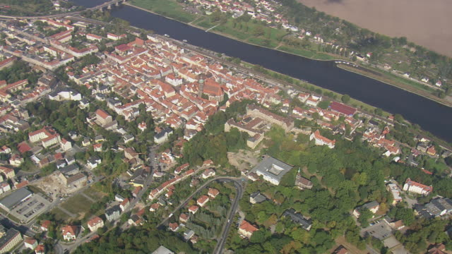 ws aerial ts view of city of pirna near elbe river and boat running on river / germany - river elbe stock videos & royalty-free footage