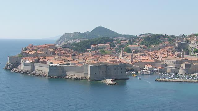 ms aerial zi view of city on harbor of adriatic sea / dubrovnik, dubrovnik neretva county, croatia - adriatic sea stock videos & royalty-free footage