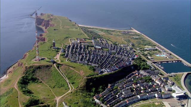 aerial ws view of city on island surrounded by ocean  / heligoland, schleswig-holstein, germany - helgoland stock videos & royalty-free footage