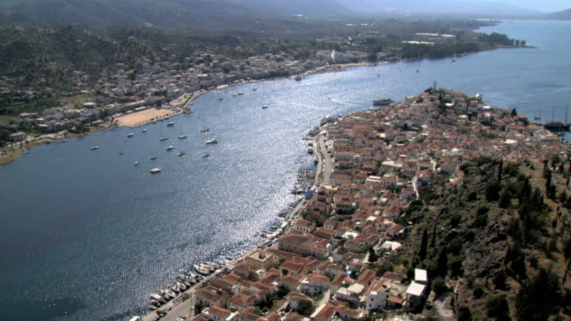 ws aerial view of city poros and its nighbor city galats  beautiful docks and ships anchored / poros, saronic islands, greece - greece stock videos & royalty-free footage