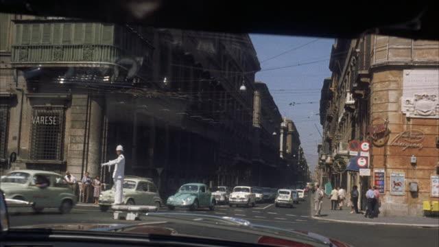 ms pov view of city / rome, italy - anno 1960 video stock e b–roll