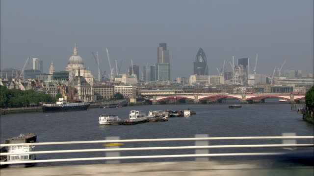 WS POV View of city skyline and St Paul's Cathedral from Waterloo Bridge / Waterloo, London, England