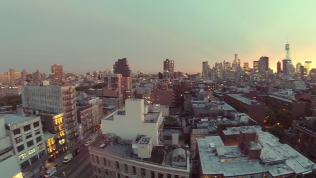 WS AERIAL PAN View of city skyline at Sun setting / New York, United States