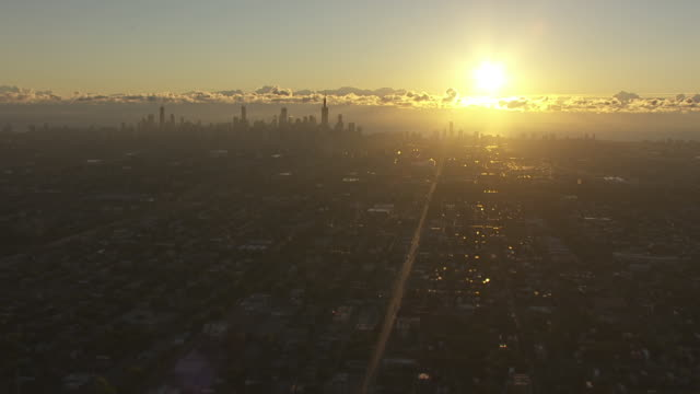 WS AERIAL POV View of city skyline at sunrise with clouds / Chicago, Cook County, Illinois, United States