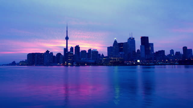 WS T/L View of city skyline at sunset / Toronto, Ontario, Canada