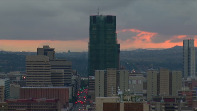 WS View of City skyline at sunset with heavy grey clouds / Pretoria, Gauteng, South Africa