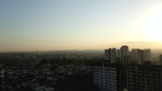 ws pan view of city skyline during sunrise / manaus, amazonas, peru - manaus stock videos and b-roll footage