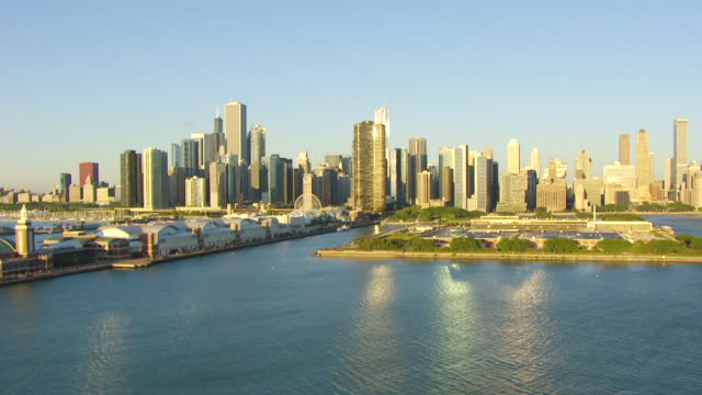 WS AERIAL POV View of city skyline with Lake Michigan and navy pier / Chicago, Cook County, Illinois, United States