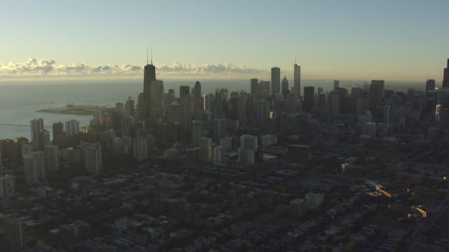 ws aerial pov view of city skyline with lake michigan in background / chicago, cook county, illinois, united states - illinois stock videos & royalty-free footage