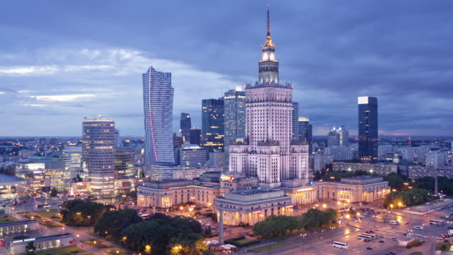 ws t/l view of city skyline with palace of culture and science at dusk / warsaw, masovian voivodeship, poland - warsaw stock videos and b-roll footage