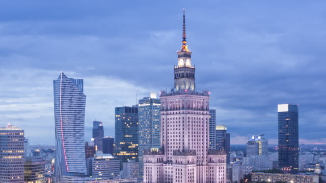 WS T/L ZO View of city skyline with Palace of Culture and Science at dusk / Warsaw, Masovian Voivodeship, Poland