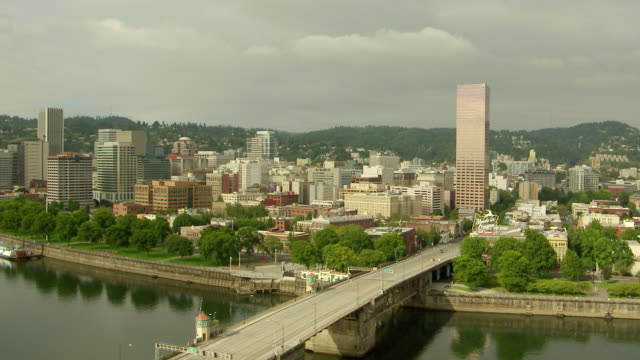 WS AERIAL View of city skyline with Willamette River and bridge
