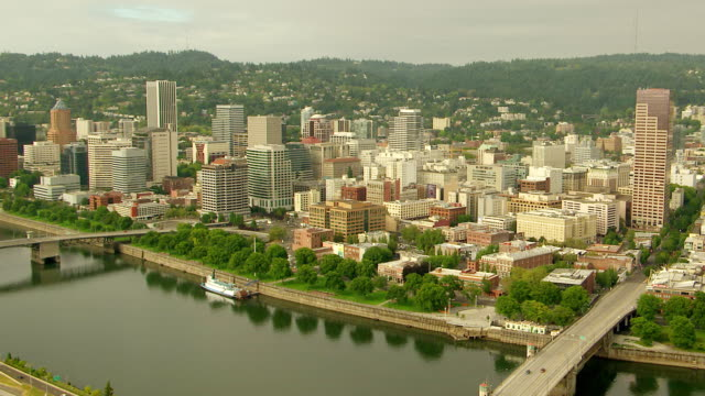 WS AERIAL View of city skyline with Willamette River and bridges / Portland, Oregon, United States