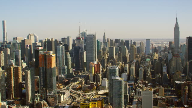 WS AERIAL View of city skyscrapers and small buildings / New York City