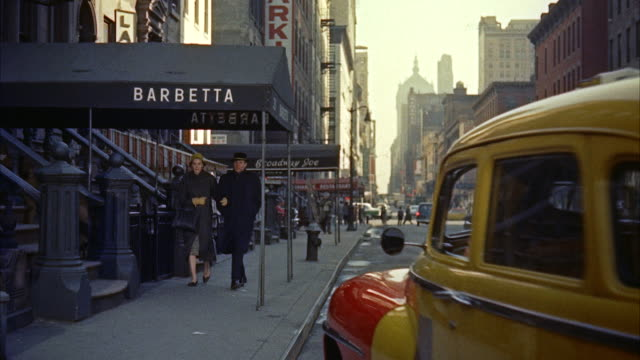ms view of city street and taxi stoping near barbetta  - 1950 1959 stock-videos und b-roll-filmmaterial