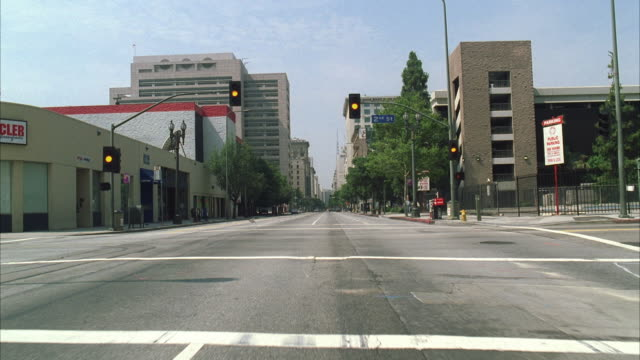 ws pov view of city street from motorbike with no traffic - road signal stock videos & royalty-free footage