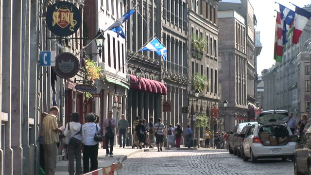 view of city street in montreal canada - montréal stock-videos und b-roll-filmmaterial