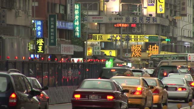 view of city street in taipei taiwan - moving past点の映像素材/bロール