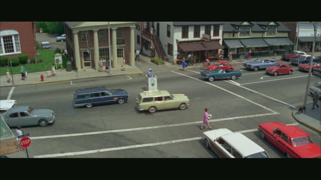 WS View of city street, traffic policeman in box / Boston, Massachusetts, USA