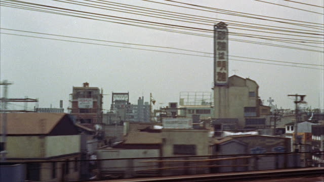 vídeos de stock e filmes b-roll de ms pov view of city / tokyo, japan - 1961