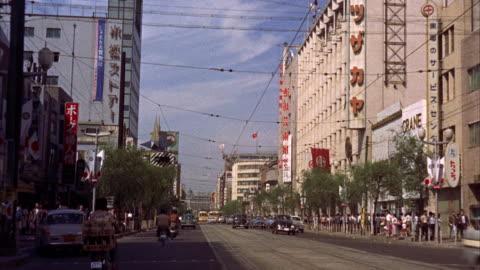 vidéos et rushes de ms pov view of city / tokyo, japan - 1961