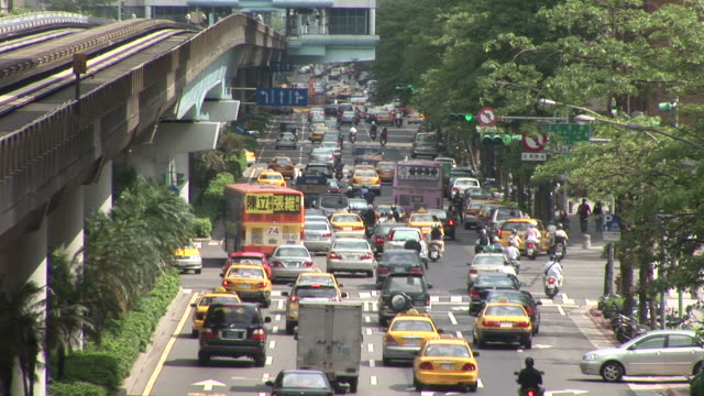 view of city traffic in taipei taiwan - fan palm tree stock videos & royalty-free footage