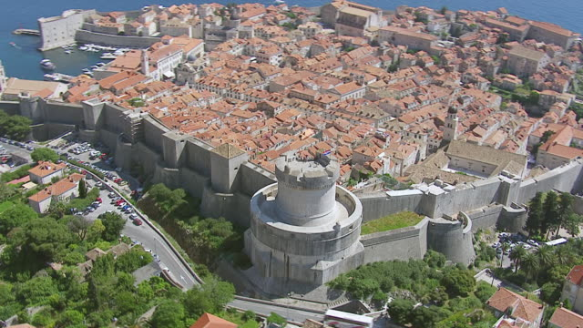 MS AERIAL DS ZO View of city wall on Adriatic sea / Dubrovnik, Dubrovnik Neretva County, Croatia