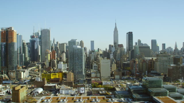 ws aerial view of city with a tower during construction and empire state building on distance / new york city   - chrysler building stock videos & royalty-free footage